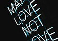 Make Love neon sign (Unsplash).jpg