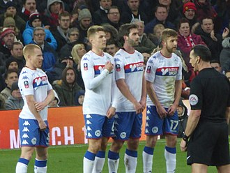 Michael Jacobs (footballer) - Jacobs (wearing No.17) in the Wigan Athletic wall, facing a Manchester United free-kick, 2017