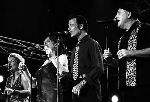"The a cappella jazz group the Manhattan Transfer had a disco hit with the 1979 ""Twilight Zone/Twilight Tone"" theme. Manhattan Transfer.jpg"
