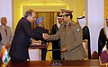 Manmohan Singh and the Prime Minister and Foreign Minister of Qatar, Sheikh Hamad bin Jassem bin Jabor al Thani witnessing the exchanging signed documents of an agreement on Defence and Security co-operation between the (1).jpg