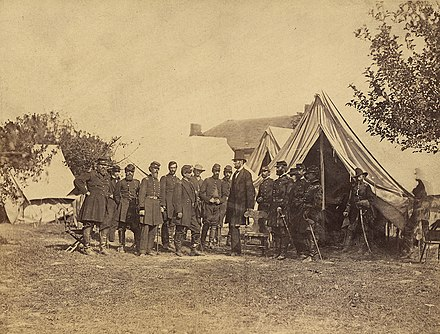Lincoln with officers after the Battle of Antietam. Notable figures (from left) are 1. Col. Delos Sackett; 4. Gen. George W. Morell; 5. Alexander S. Webb, Chief of Staff, V Corps; 6. McClellan;. 8. Dr. Jonathan Letterman; 10. Lincoln; 11. Henry J. Hunt; 12. Fitz John Porter; 15. Andrew A. Humphreys; 16. Capt. George Armstrong Custer. Maryland, Antietam, President Lincoln on the Battlefield - NARA - 533297.jpg