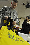 Master Sgt. William Sander show Missouri Wing CAP cadet how to properly prepare search and rescue equipment.JPG