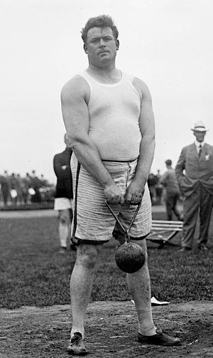 Matt McGrath - Matt McGrath holding a 56lb weight