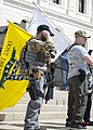 Men with firearms and flags at the rally against gun control at the Minnesota State Capitol.jpg