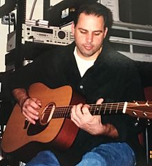 Mangini playing guitar