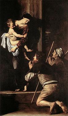 Tableau représentant deux pèlerins agenouillés devant Marie portant Jésus enfant.