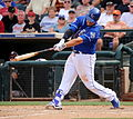 Mike Moustakas swings at a pitch (25090046553).jpg