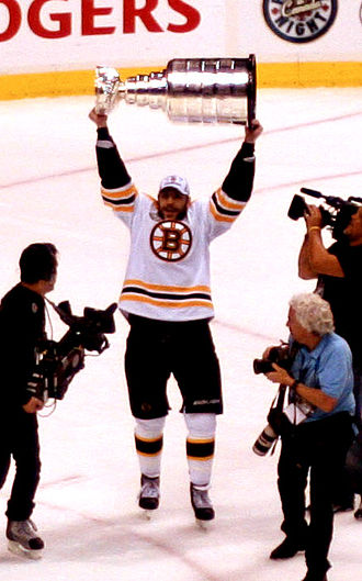Milan Lucic - Lucic celebrates with the Stanley Cup following the Bruins' Game 7 win against the Vancouver Canucks.
