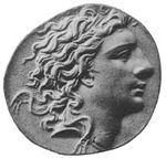 Photo of an ancient coin shows a clean-shaven man with wavy hair.