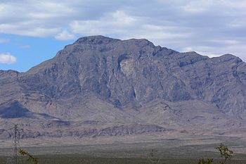 View of Moapa Peak from near the Carp-Elgin ex...