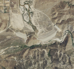 Mojave Forks Dam - Satellite view, showing the main dam and spillway to the right, and auxiliary dam to the left. The Mojave River flows north (up) downstream of the dam.