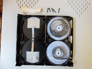 Media preservation - A badly molded VHS tape. Mold can grow due to humidity on the storage space, and then prevent modern usage.