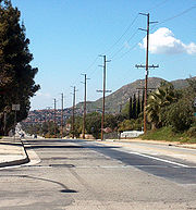 A view of Moreno Valley looking west down Ironwood Avenue. Box Springs Mountain is visible at right.