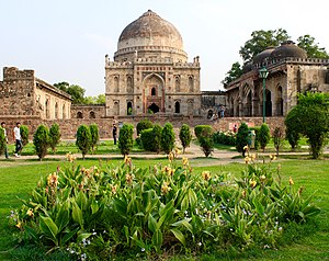 Mosque with the dalans and courtyard and the Bara Gumbad (the domed entrance to the mosque).jpg