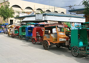 Bantayan, Cebu - Trisikads (and one tricycle) for hire lined up outside public market in downtown Bantayan