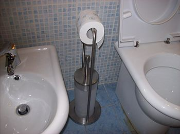 Multi-orientable Italian toilet paper holder