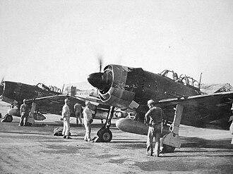 343rd Naval Air Group - Captured Kawanishi N1K2-Js having their Homare engines run up by former JNAF groundcrew