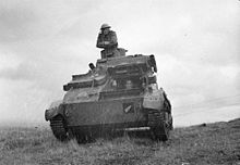 Tank facing the camera, with a soldier on top