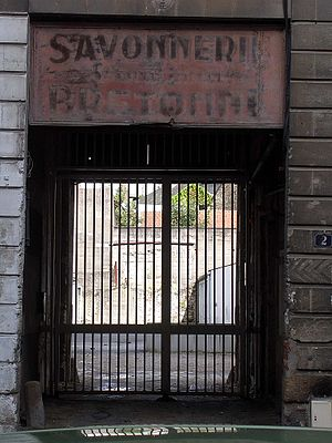 Drownings at Nantes - A fading 19th-century soap factory sign above the gate of the former 18th-century Coffee Warehouse jail in Nantes
