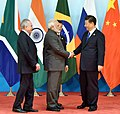 Narendra Modi being received by the President of the People's Republic of China, Mr. Xi Jinping, at the Dialogue of Emerging Markets and Developing Countries, during the 9th BRICS Summit, in Xiamen, China (1).jpg