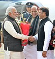 Narendra Modi being welcomed by the Chief Minister of Uttar Pradesh, Shri Akhilesh Yadav, on his arrival, at Lucknow airport, in Uttar Pradesh on January 22, 2016. The Union Home Minister, Shri Rajnath Singh is also seen.jpg
