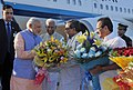 Narendra Modi being welcomed by the Governor of Karnataka, Shri Vajubhai Rudabhai Vala, the Chief Minister of Karnataka, Shri Siddaramaiah and the Union Minister for Law & Justice, Shri D.V. Sadananda Gowda on his arrival (1).jpg