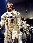 Neil Armstrong (front), Mike Collins, and Buzz Aldrin leave for the launch pad.jpg