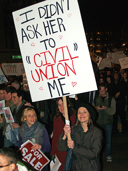 Various advocates of same-sex marriage, such as this protester at a demonstration in New York City against California Proposition 8, consider civil unions an inferior alternative to legal recognition of same-sex marriage. New York City Proposition 8 Protest outside LDS temple 20.jpg