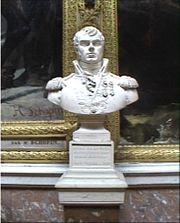 Bust of man with a dimple on his chin. He wears an early 1800s military uniform with high collar.