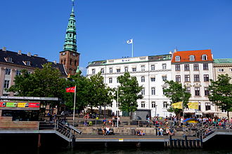 Nordic Council - Nordic Council headquarters in Copenhagen. White building with Norden sign and flag at street Ved Stranden No. 18