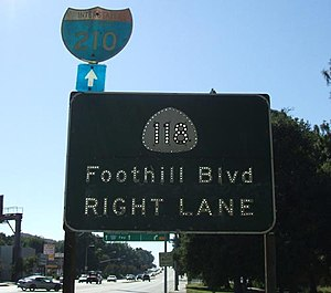 California State Route 118 - An old SR 118 shield on the relinquished segment on Foothill Boulevard, east of I-210 in Sunland. Note that California presently uses green shields, while this one dates to the 1950s or 1960s.
