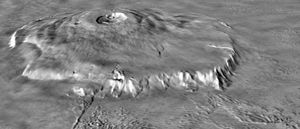 Olympus Mons - Oblique view of Olympus Mons, from a Viking image mosaic overlain on MOLA altimetry data, showing the volcano's asymmetry. The view is from the NNE; vertical exaggeration is 10x. The wider, gently sloping northern flank is to the right. The more narrow and steeply sloping southern flank (left) has low, rounded terraces, features interpreted as thrust faults. The volcano's basal escarpment is prominent.