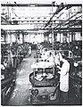 Operai al lavoro nel reparto stampaggio sfere e rulli dello stabilimento Riv di Villar Perosa, Torino 1939 – 1949.jpg