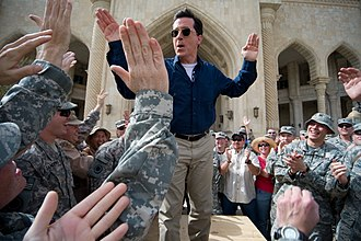 "Stephen Colbert - Stephen Colbert greets troops and civilians at Al Faw Palace at Camp Victory in Baghdad, Iraq, June 5, as part of his ""Operation Iraqi Stephen: Going Commando"" tour"