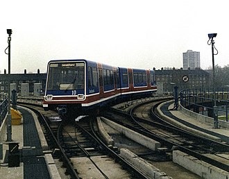 Docklands Light Railway rolling stock - P86 stock passing through the flat junction at Poplar bound for Stratford, 1987