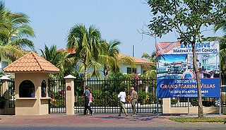 Gated community Community with controlled entrances and often a closed perimeter of walls/fences
