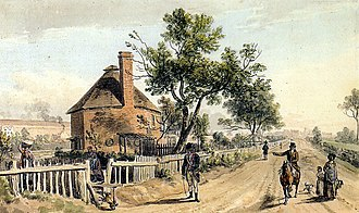 Powis Street - The same dirt track from the west, with the octagonal building