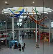 Terminal 1 interior, Jonathan Borofsky's I Dreamed I Could Fly