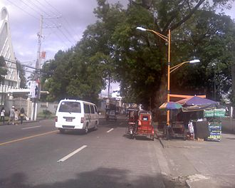 Santa Cruz, Laguna - Pedro Guevara Avenue, in front of the Iglesia ni Cristo church (left).