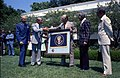 Photograph of President Gerald Ford Presenting the NASA Distinguished Service Medal to the Manager of the Apollo-Soyuz Test Project and the Apollo Astronauts - NARA - 7347188.jpg