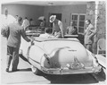 Photograph of President Truman getting into his automobile after lunch at a hotel near Aguas Buenas, Puerto Rico, for... - NARA - 200464.tif