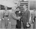 Photograph of President Truman shaking hands with Secretary of State Dean Acheson at the airport in Washington, as... - NARA - 200117.tif