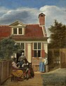 26 / Three women and a man in the courtyard behind a house