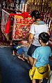 Pilgrims crawling beneath the divine palanquin at the Lukang Tianhou Temple (Taiwan).jpg