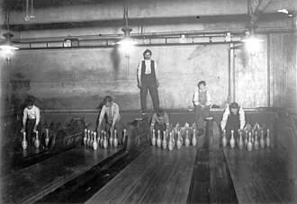 Pinsetter - April 1910: 1:00 A.M. Pin boys working in Subway Bowling Alleys, 65 South St., Brooklyn, New York, Lewis Hine photo