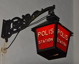 Police station - Red sign outside a Swedish police station