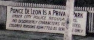 "Ponce de Leon amusement park - Sign at entrance 1908 indicating ""colored persons admitted as servants only"""