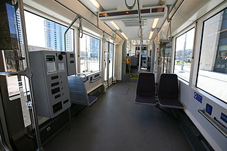 Portland Streetcar - Interior of a Portland streetcar, with ticket vending machine