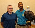 Posing for picture with Bald Eagle. (10595048653).jpg