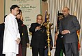 Pranab Mukherjee lighting the lamp on the occasion of the International Literacy Day celebrations, in New Delhi. The Union Minister of Human Resource Development, Shri M.M. Pallam Raju.jpg